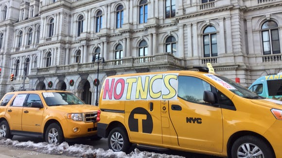 Members of the New York Taxi Workers Alliance traveled to the state Capitol on Wednesday to protest an effort to legalize Uber and other ride-sharing networks across the state.