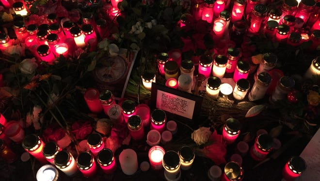 Memorial candles and signs at Breitscheidplatz Christmas market in Berlin on Dec. 22.