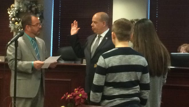 Frank Valenzuela, alongside his family, is sworn in as mayor of Rochelle Park at the Township Committee's annual reorganization meeting on Sat., Jan. 7, 2017.
