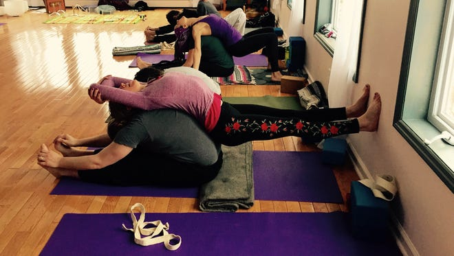 Schedule a slot at a partner yoga session to unwind this winter.