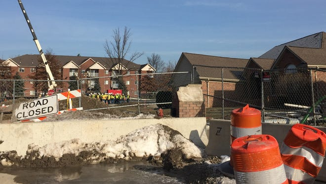 Michigan Congressional members, Macomb County commissioners and other state and local officials on Jan. 15, 2017, tour the sewer interceptor collapse and sinkhole on 15 Mile in Fraser that was discovered Dec. 24, 2016 and condemned three houses.