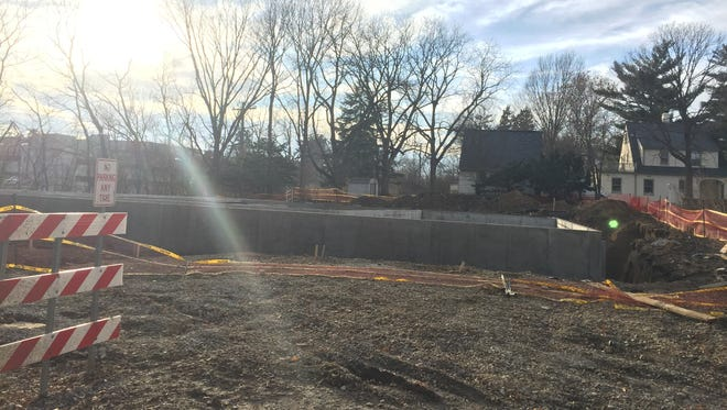 The foundation of the planned Kinnick Stadium-style house sits at 101 Lusk Ave. on Monday, Jan. 30, 2017.