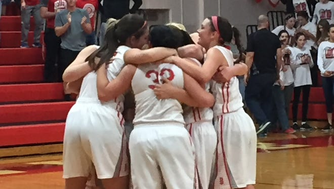 Bellevue's girls gather for hugs Saturday after earning a share of the NOL crown.