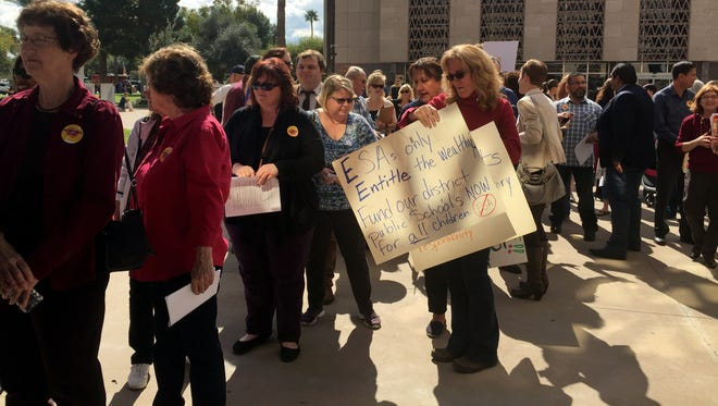 Students and their parents used their day off from school to wield signs at the state Capitol and deliver postcards to the state's legislative leaders.