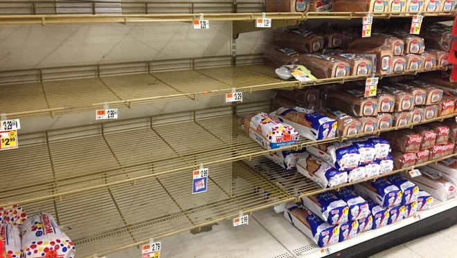 Empty bread shelves at the Stop & Shop at New Roc City in New Rochelle on Monday.