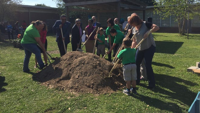 Lafayette Parish School System officials, L. Leo Judice faculty and students break ground on a new school library.