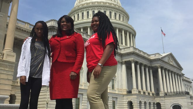 "McKenzie Beckles, 12, of New York, left, and Ashanti Williams, 14, of Georgia, join Rep. Terri Sewell at the U.S. Capitol Thursday for ""Take Your Daughter to Work Day."" Sewell said it's important for young people to explore career possibilities, including being a member of Congress."