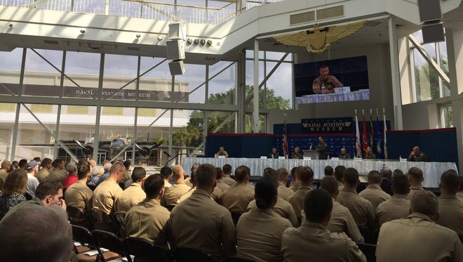 Military members listen to a panel discussion moderated by Vice Adm. Mike Shoemaker, commander of Naval Air Forces, on May 12, 2017, at the National Naval Aviation Museum's annual symposium.