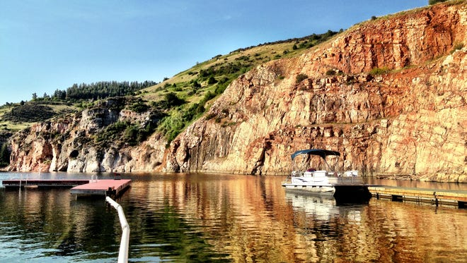 A pontoon is docked at the Ok-A-Beh Marina in the Bighorn Canyon National Recreation Area near Fort Smith, southeast of Billings amid the Crow Indian Reservation.