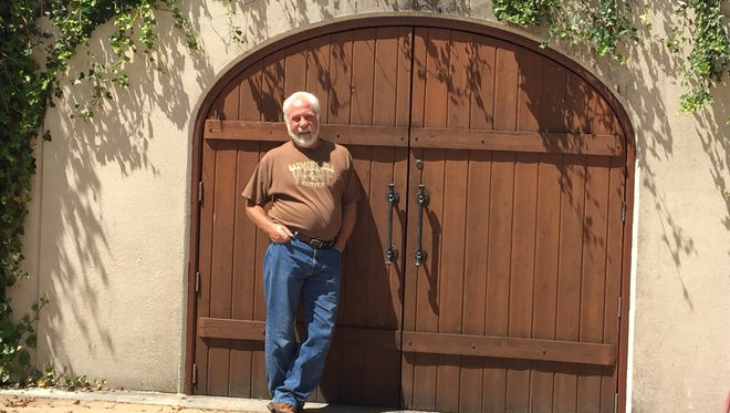 Harmony Hill Vineyard owner and wine maker Bill Skvarla standing in front of his wine cave.