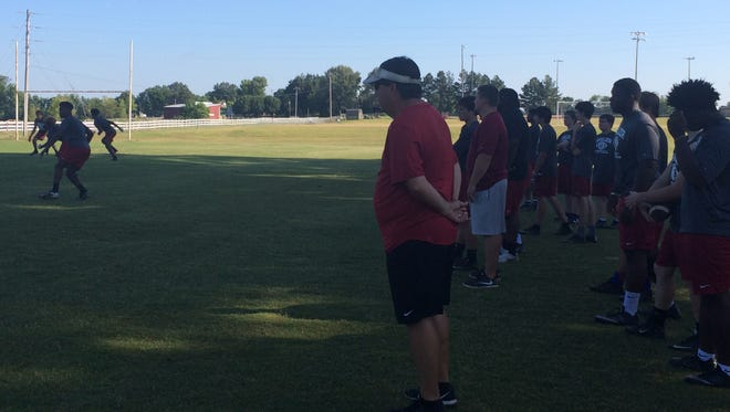 Crockett County coach Kevin Ward watches the team work on its offense Tuesday morning.