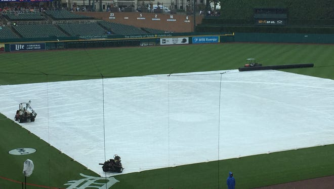 The tarp on the field at Comerica Park, June 18, 2017 before the Tigers vs. Rays game.