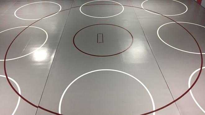 Genoa has new mats for its wrestling room.