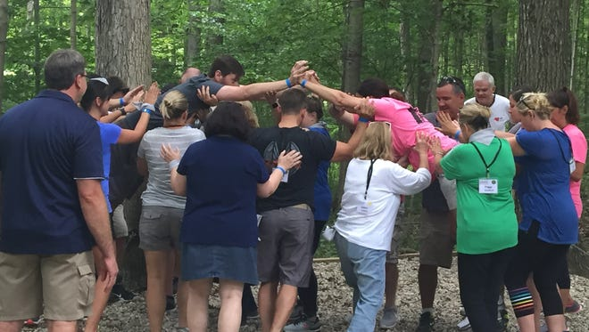 Members of the LEAD Clermont Classic class of 2018 work on a team-building exercise at Camp Joy.
