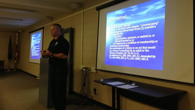 Mike McIver, a Lafayette police officer, speaks about gangs during a recent citizens academy course.