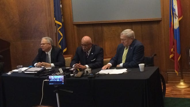 Attorney E. Powell Miller, left, Wayne County Executive Warren Evans and Oakland County Executive L. Brooks Patterson discuss their lawsuit against drug makers over the opioid crisis during a news conference Thursday in Detroit.