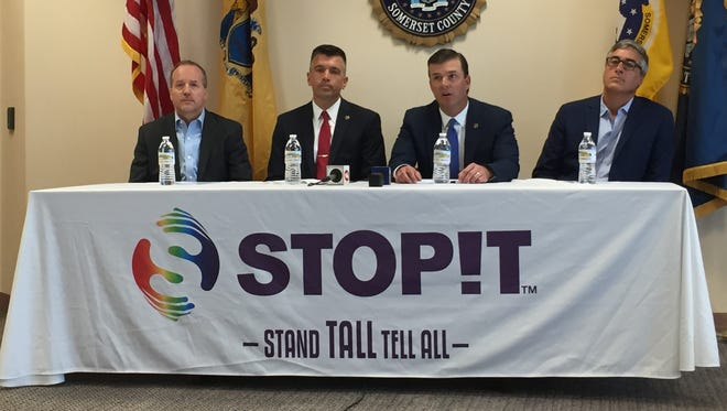 Somerset County Prosecutor Michael Roberttson, second from left, with STOPit company officials and John Fodor, chief of detectives at the county prosecutor's office.
