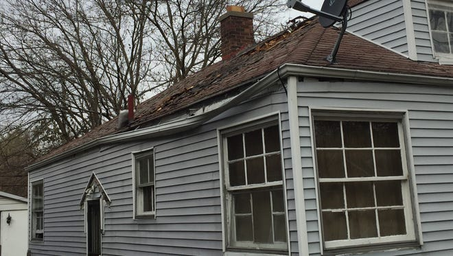 Damage from the fire appears to be self-contained insidethe house, which has a hole burnt through itsroof. Fire damage isvisible from the outside ofthe room where the boy died.