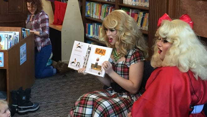 """Nikki Champagne and Emoji Nightmare encourage kids to roar while reading """"Mr. Tiger Goes Wild"""" during Drag Queen Story Hour at Fletcher Free Library in Burlington."""