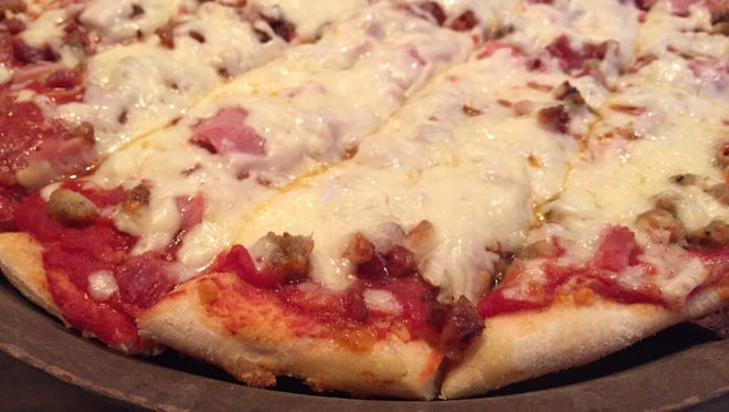 Bruno's meats pizza served Thursday, Dec. 28, 2017, at Bruno's Pizza and Big O's Sports Room in West Lafayette.