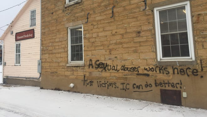 Graffiti on The Haunted Bookshop in Iowa City is shown on Jan. 11, 2018.