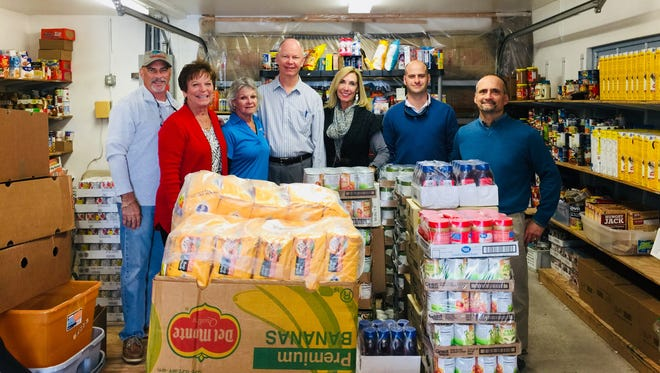 Sebastian Exchange Club members, from left, Mike Natale, Karen McElveen, Margie Duffell, Jeff Slade, Kathy Falzone, Andrew Rich and Tony Donini with the $1,250 worth of food products donated to the Ecumenical Council Food Pantry at Roseland United Methodist Church.
