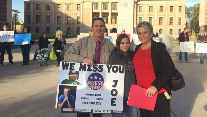 Steve, Jamie and Tana Smith stand outside the Arizona State Capitol before addressing the Senate Judiciary Committee about their bill, SB 1210.