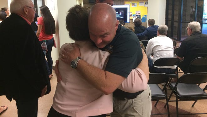 Randy Retter receives congratulations from Betty Smith-Henson after he learned he won the Republican primary for Wayne County sheriff.