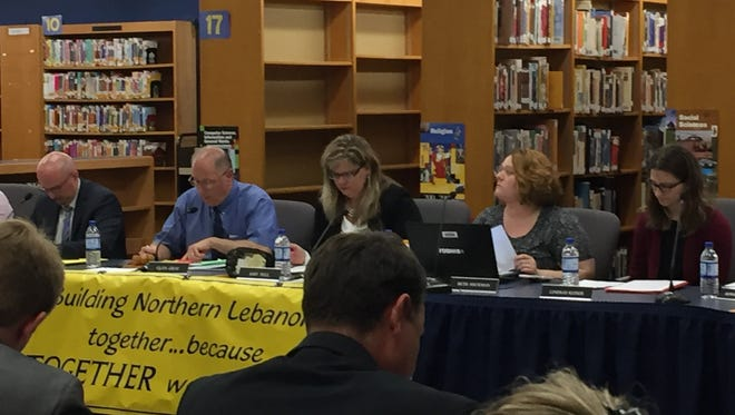 Northern Lebanon School District school board member Beth Heckmen, second from right, resigned from her position at a May 8, 2018 school board meeting in protest of a sex toy scandal involving three principals.