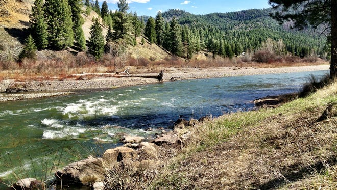 Officials have issued a flood warning for Missoula as snowmelt and rain causes the Clark Fork River to rise.