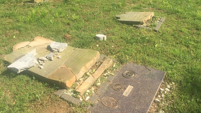 The once restored gravestone of Gen. Samuel Hopkins lies shattered Wednesday and knocked over with pieces of another gravestone.