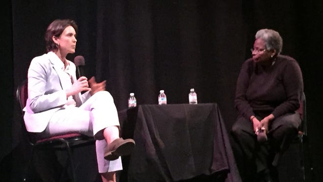 More than 200 people gathered Friday morning to hear the Rev. Jasmine Beach-Ferrara (left) and keynote speaker Mandy Carter deliver opening remarks at the Diana Wortham Theatre for the kickoff of the second annual LGBT in the South Conference, organized by the Campaign for Southern Equality.