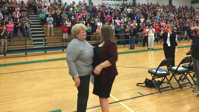 Dayton High School students and staff give finance clerk Linda Brandenburg a standing ovation Friday as the community and state honored her three decades of service.
