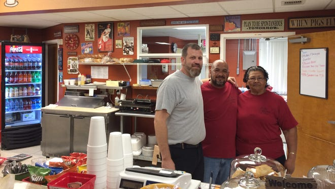 Tony Clark, left, and Shawn Leiva own The Gathering Place in south Fort Myers. Many of their recipes come from Leiva's mother, Anita, right.