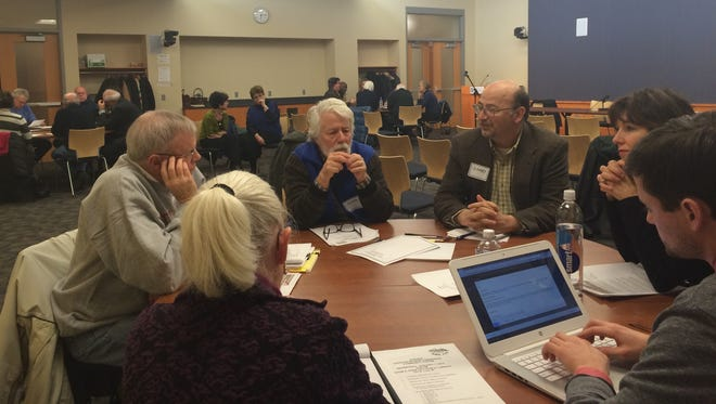 About 20 members of the community engaged in discussions about the Iowa City Home Rule Charter at the Charter Review Commission's second open forum at the Iowa City Public Library on Wednesday.