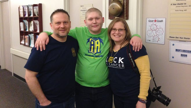 Harrison High School junior Alex Smith, pictured here with parents Jeff and Debbie Smith, was diagnosed with Hodgkin's lymphoma in July. He has finished his radiation and chemotherapy treatments is awaiting an update from his doctor on Thursday.
