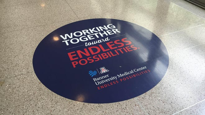 The merger that created Banner-University Medical Center Phoenix became official at midnight on Friday, Feb. 27. By Saturday, signs were being changed, and 27 large, circular floor decals trumpeting the new name and slogan were put in place the same weekend.