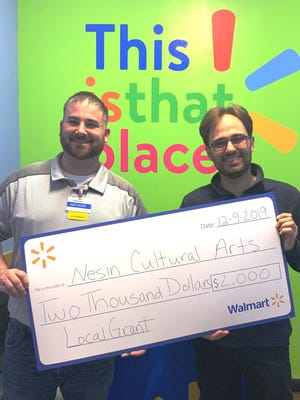 Monticello Walmart Manager Anthony Cilibrasi, left, presents a $2,000 Community Grant check to Sullivan County Chamber Orchestra Artistic Director Andrew Trombley.