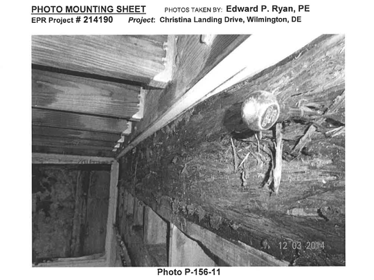 A photo from an inspection report for a home at Christina Landing appears to shows a rotting structural beam.