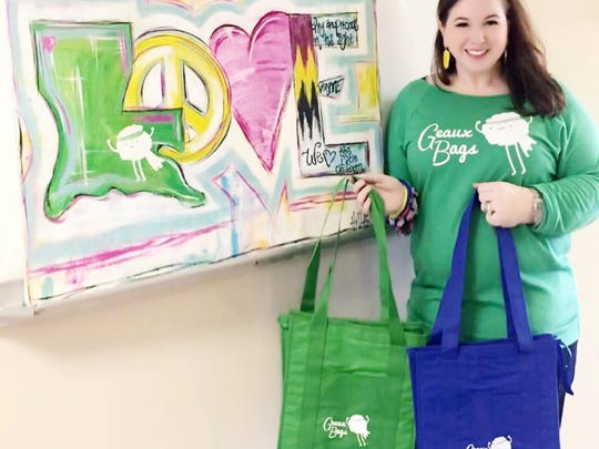 KTBS's K.C. Kilpatrick holds Geaux Bags - green for