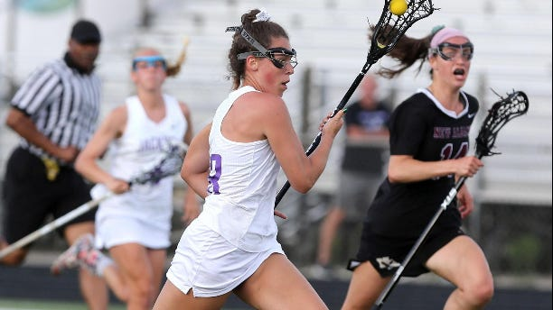 Jackson's Abigail Lair runs with the ball during a lacrosse game last season.