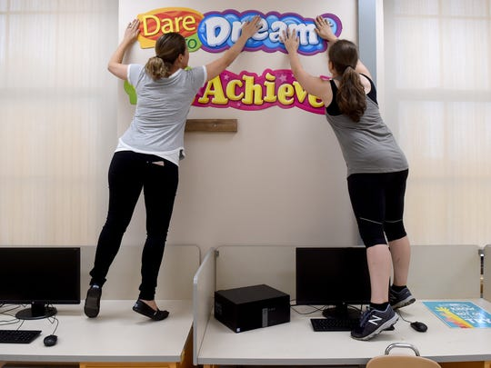STEAM teacher Kate Fiocchi, left. and Tech-Ed teacher Erica Schmuck Wilson prepare the Makerspace classroom at Edgar Fahs Smith STEAM academy. After closing in 2012, the school will reopen Aug. 21 with a curriculum emphasizing science, technology, engineering, the arts and math.