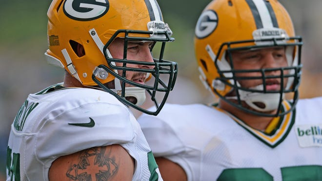 Don Barclay (67), left, during Green Bay Packers Training Camp at Ray Nitschke Field Aug. 19.