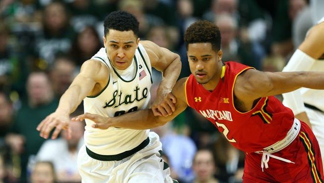 Michigan State Spartans guard Travis Trice (20) and Maryland Terrapins guard Melo Trimble (2) fight for loose ball during the 2nd half of a game at Jack Breslin Student Events Center.