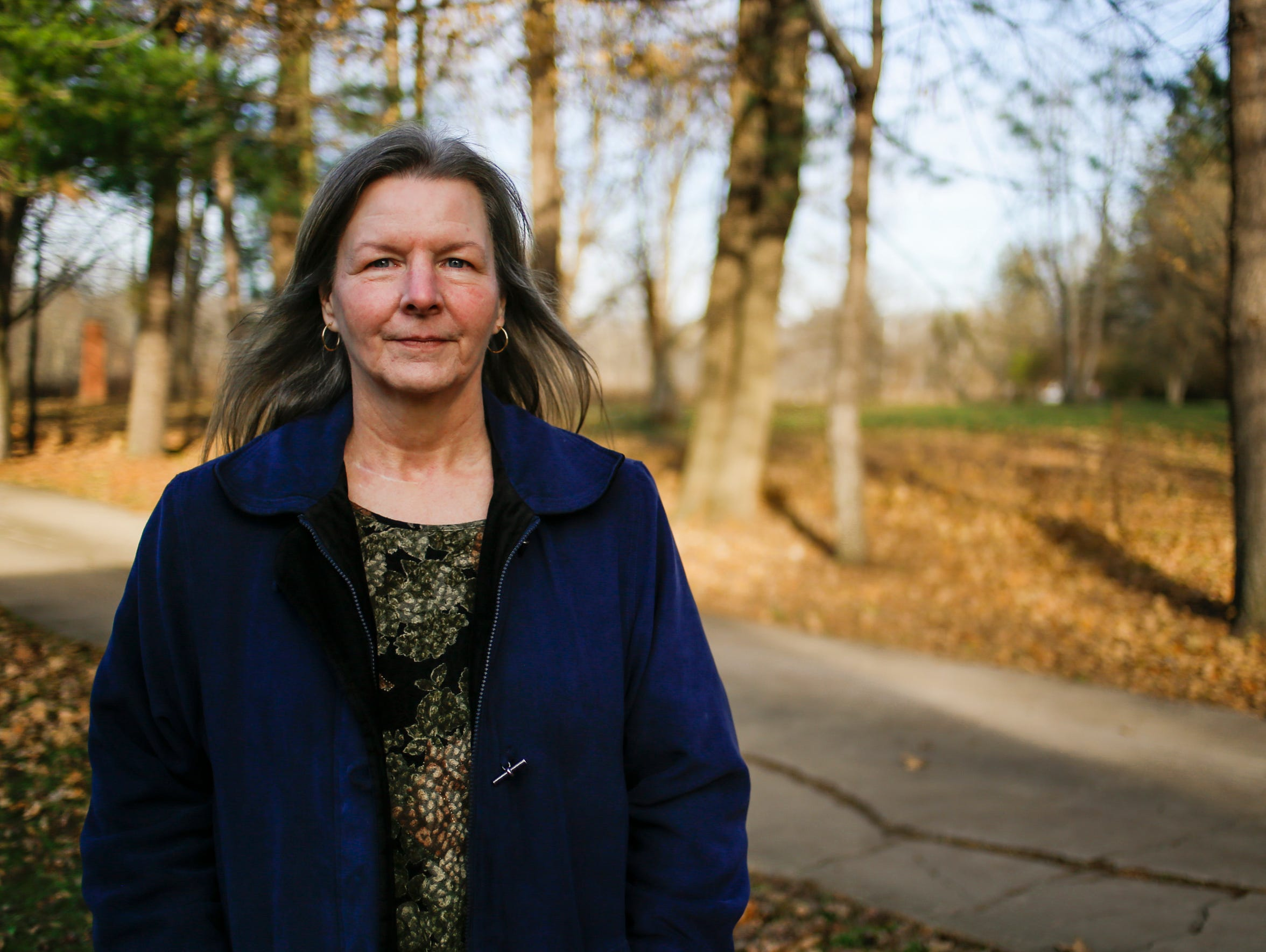 Dena Oyler, 58, of Grand Rapids, is a caregiver and marijuana patient. She says caregivers offer more personal service than dispensaries and worries they may be pushed out by large scale growers.