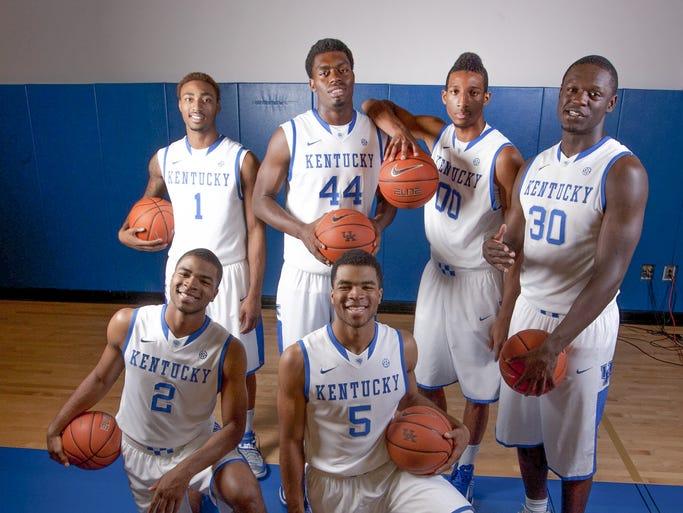 Kentucky freshmen James Young (1), Dakari Johnson (44), Marcus Lee (00), Julius Randle (30), Aaron Harrison (2) and Andrew Harrison (5) pose during Kentucky Media Day at the Joe Craft Center.