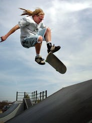 Seth Hanninen of Waukesha does a trick on a ramp at the town of Delafield Sports Commons Skate Park.