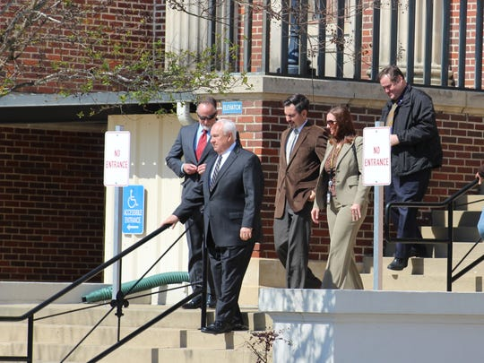 Members of the prosecution's team leave the Avoyelles Parish Courthouse for lunch recess Wednesday, just after four more potential jurors were selected in the Derrick Stafford case.