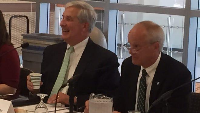 Tom Tranter, president of Corning Enterprises, left, and Harvey Stenger, BInghamton University president, preside over Thursday's meeting of the Southern Tier Regional Economic Council at the Binghamton University Innovative Technology Center.