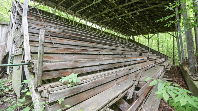 Wooden bleachers with a metal roof still stand at the now closed Jungle Park SpeedwayThursday May 12th, 2016. The 1/2 mile Jungle Park Speedway, on the banks of Sugar Creek near Turkey Run State Park in Parke County, Indiana opened in 1926 and operated on and off until closing in 1960.